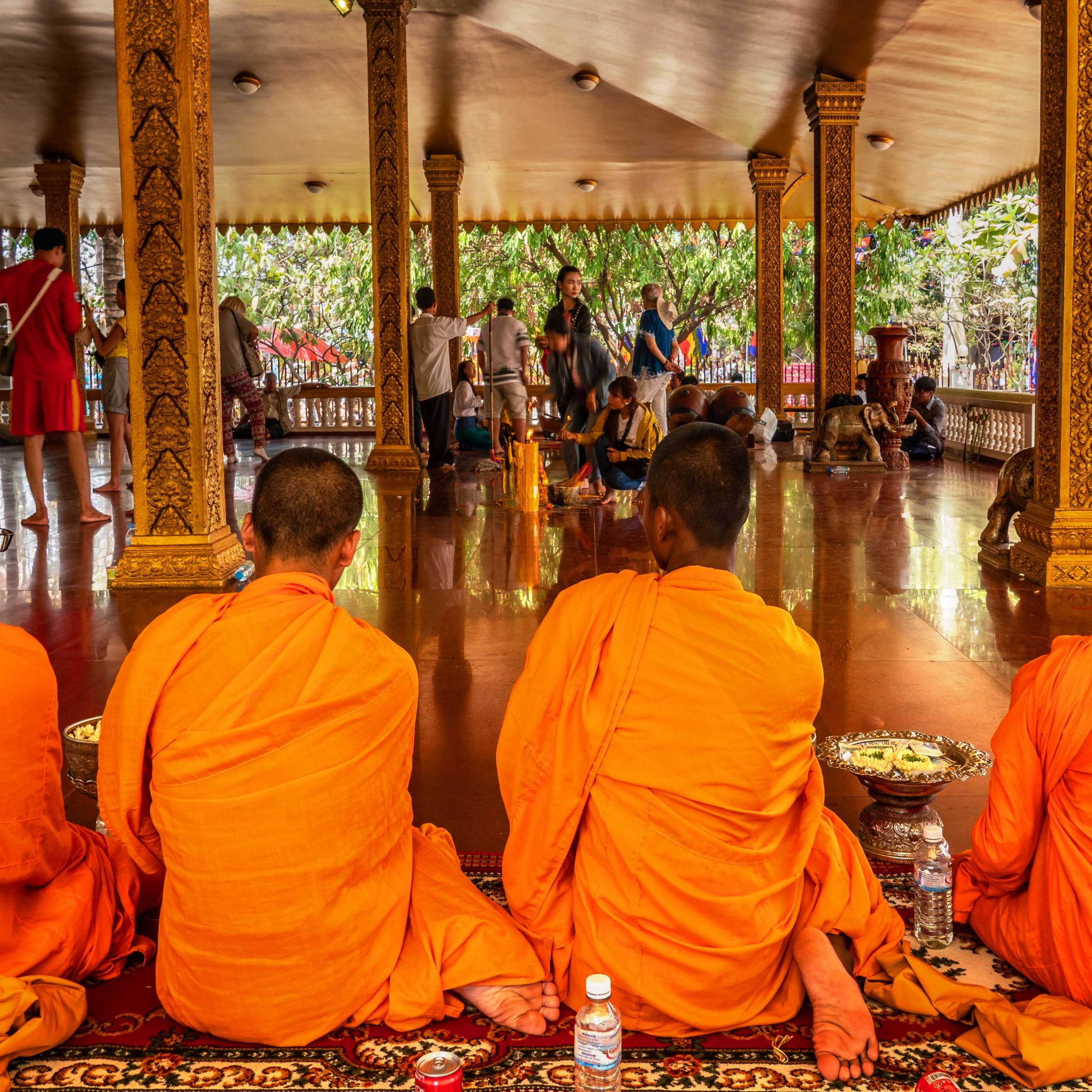 MONKS PRAYING IN A TEMPLE IN SIEM REAP