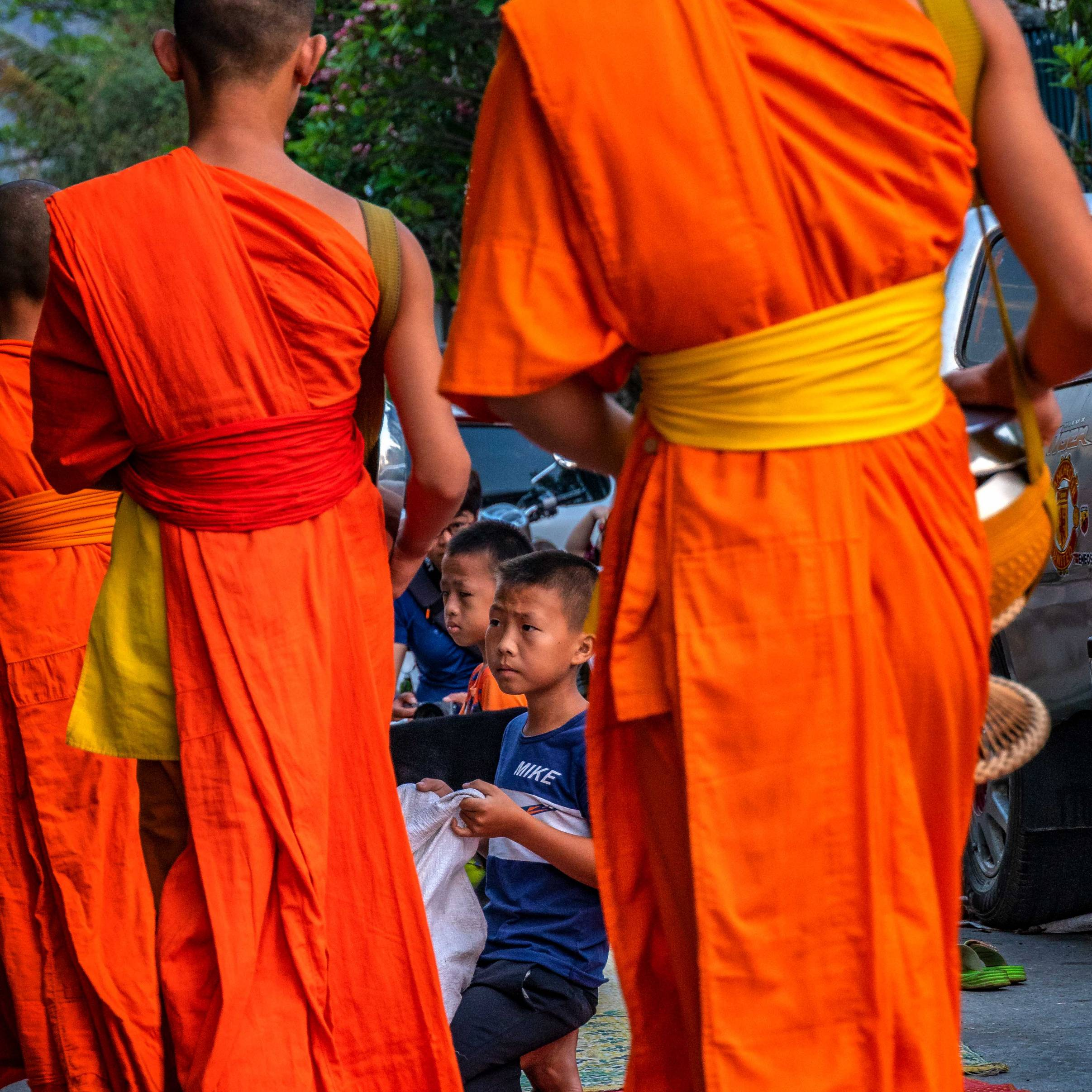MONKS GIVING ALMOSES IN LUANG PRABANG