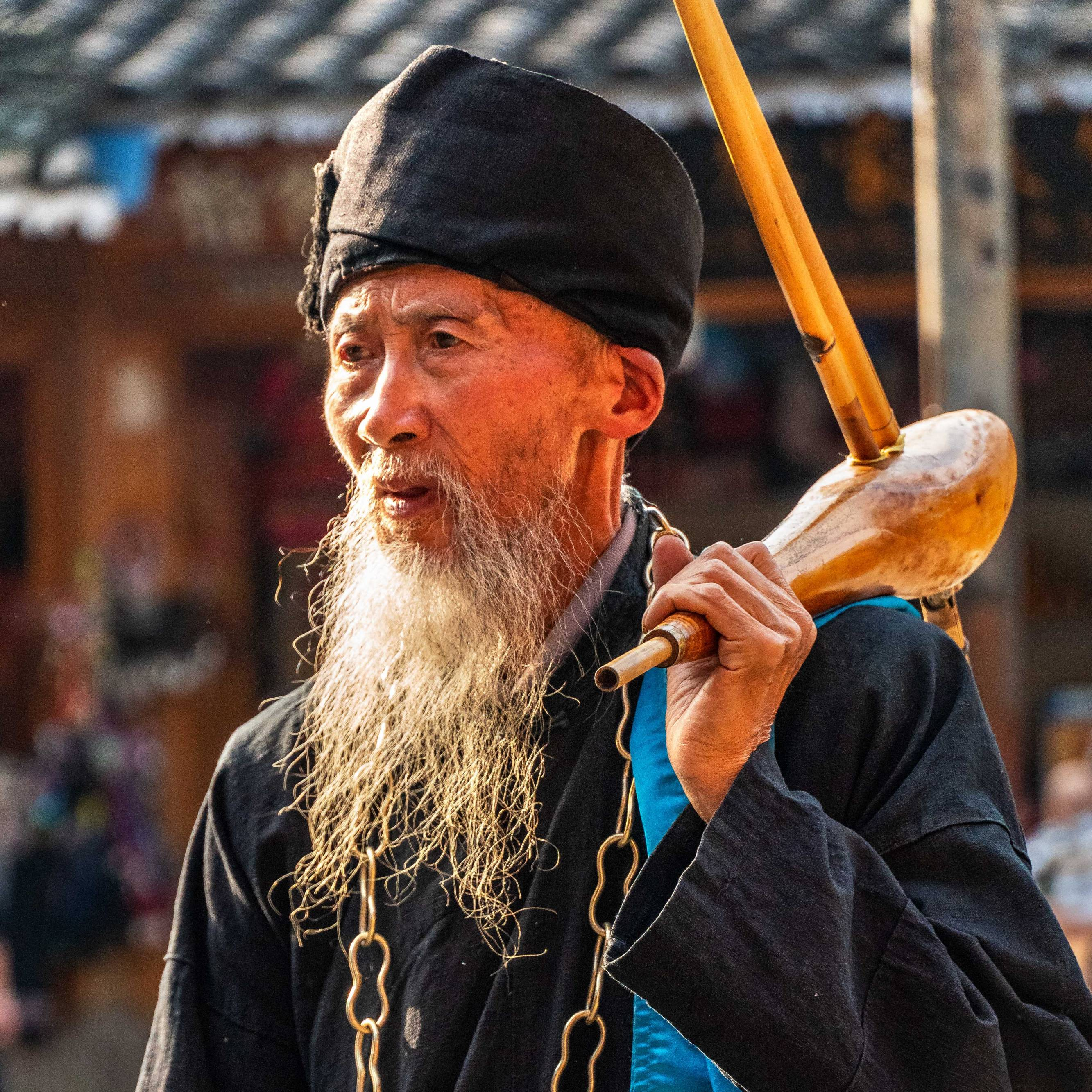 Man wearing traditional clothes and instrument, Dong Village, Province Yunnan