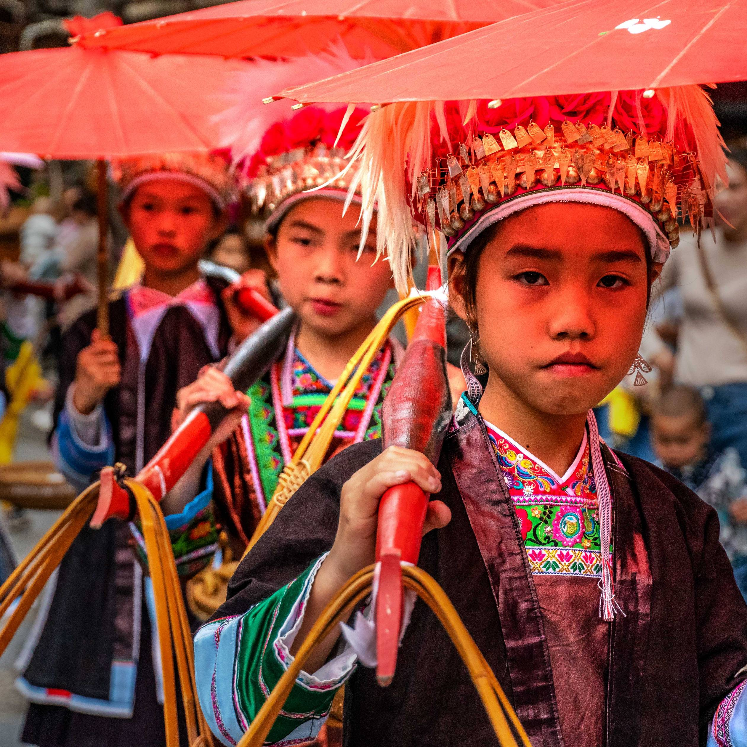Children presenting traditional clothes of the Miao ethnic group, Hua Zhuang Miao Village, Province Yunnan