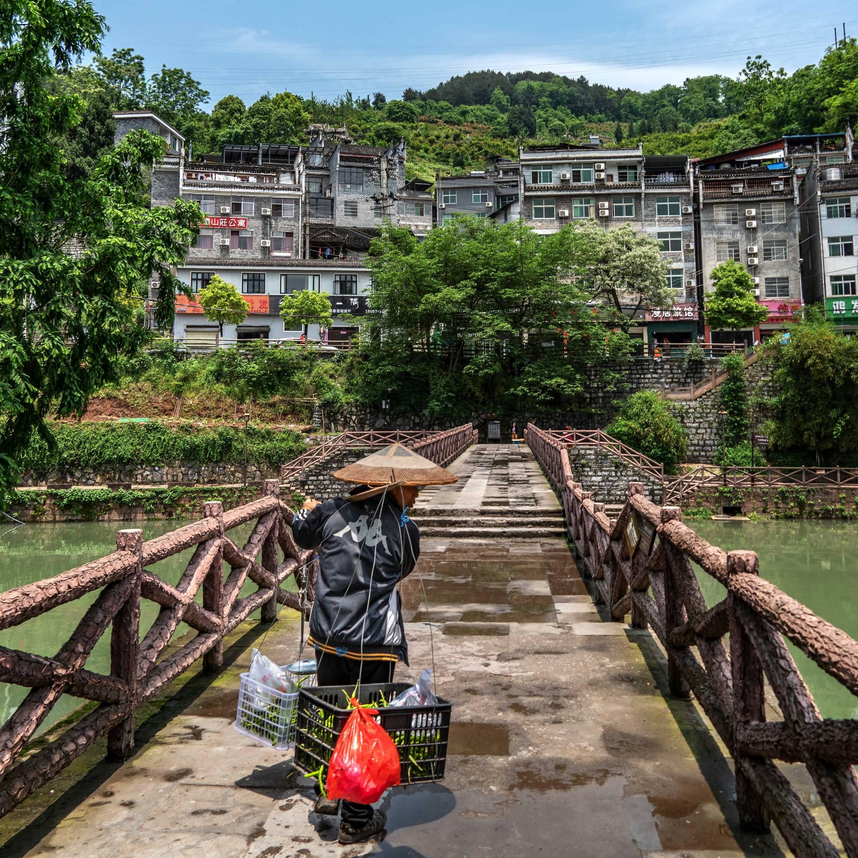 Chinese Man Selling Vegetables in Fenghuang